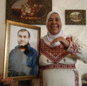 The mother of Palestinian prisoner Adnan Maragha and her son, who is among the 1,027 Palestinian prisoners to be freed ...
