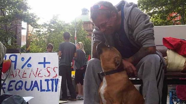 Peter Williams and his dog Achilles at the protest site this morning.