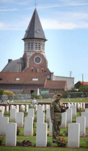Poignant place … an Australian soldier pauses to reflect in the Fromelles cemetery.