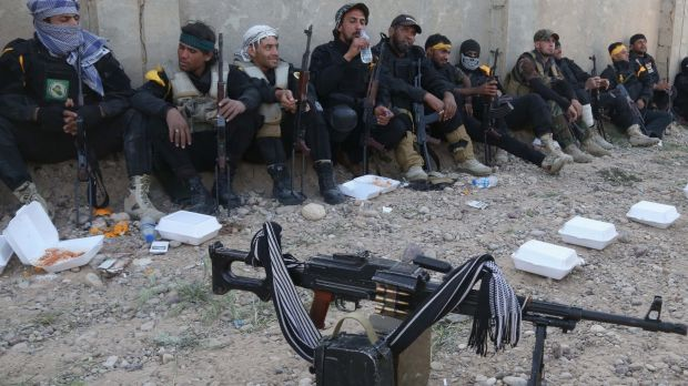 Iraqi Shi'ite militants rest near the front line with Islamic State in Tikrit.