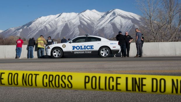 Officials respond to a report of car in the Spanish Fork River in Spanish Fork, Utah, where an 18-month-old girl ...