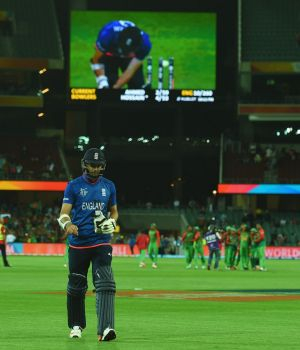 Instant replay:  James Anderson trudges off as his dismissal in shown on the big screen at the Adelaide Oval.
