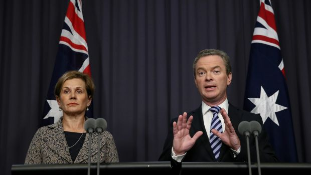 Education Minister Christopher Pyne, pictured with Universities Australia chief executive Belinda Robinson, announces ...