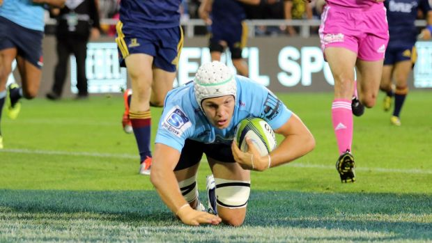 Bright spot: Stephen Hoiles scores a try against the Highlanders.