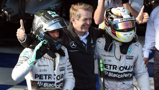 British driver Lewis Hamilton (right) celebrates with teammate German driver Nico Rosberg (left) and Thomas Weber ...