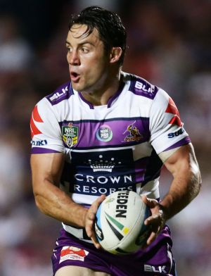 Cooper Cronk gets ready to pass during the match against Manly.