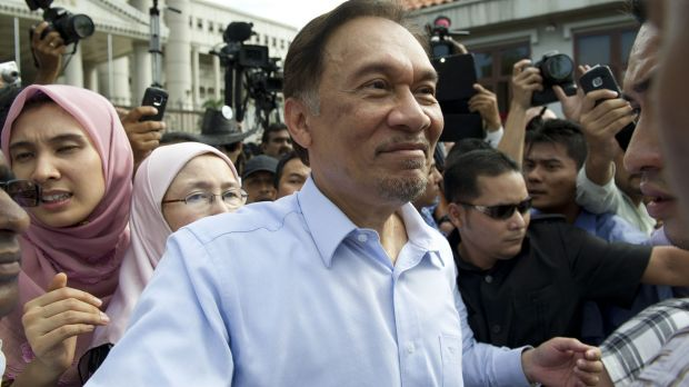 Anwar Ibrahim and his daughter Nurul (left) outside court in 2012 following an earlier acquittal over sodomy charges.