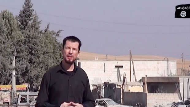 An image grab taken from a video released by IS in October 2014 purportedly shows 43-year-old kidnapped British reporter ...