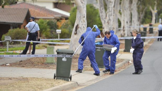 Forensic officers and police investigate the stabbing death of a woman, 28, in Gordon on Tuesday.