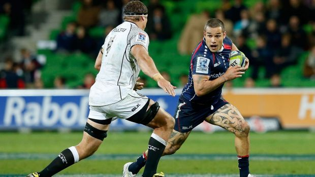 Tamati Ellison of the Rebels evades Willem Alberts of the Sharks.