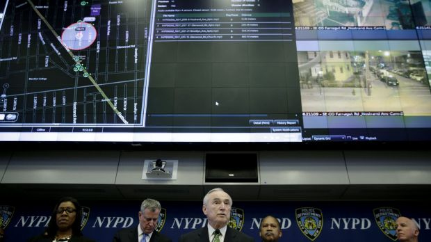 New York City police commissioner Bill Bratton, centre, speaks during a news conference at police headquarters in New York.