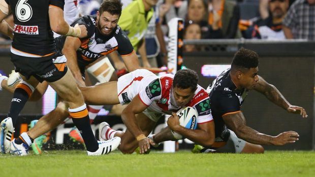 Rare sight: Dane Nielsen crosses for a try against Wests Tigers on Monday night.