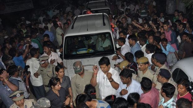 The car carrying Indian Chief Minister of the state of West Bengal Mamata Banerjee (centre) is surrounded by angry ...