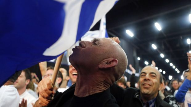 A Likud supporter reacts after hearing exit poll results in Tel Aviv on Tuesday.