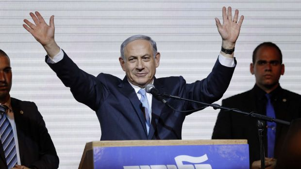 Israeli Prime Minister Benjamin Netanyahu waves to supporters in Tel Aviv after claiming victory at the polls.