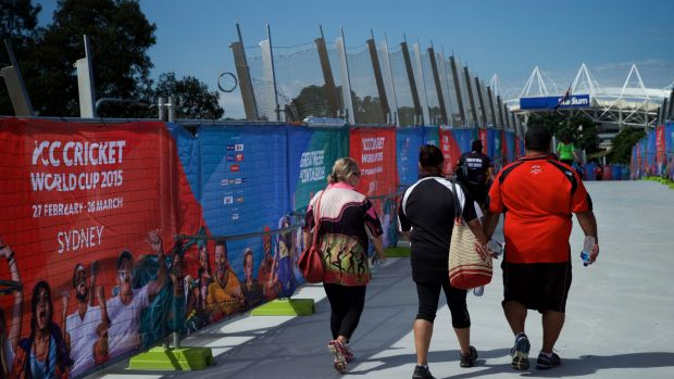 Pedestrians using the Albert Tibby Cotter Bridge over Anzac Parade during the world cup.