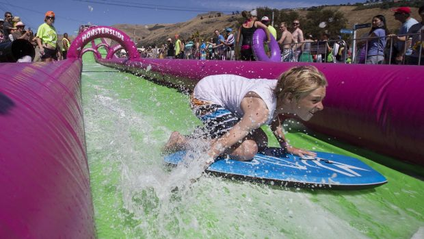 A child rides the monster slide in New Zealand.