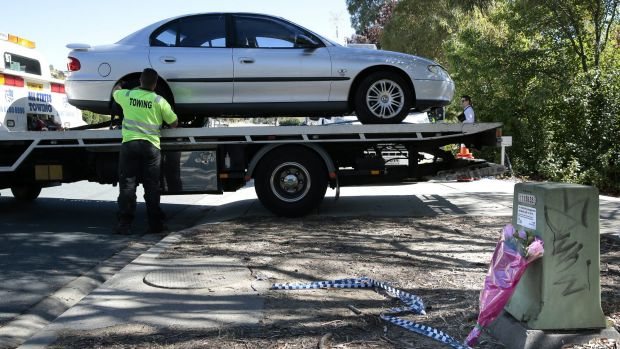 A car is removed from the house by ACT Policing on Thursday.