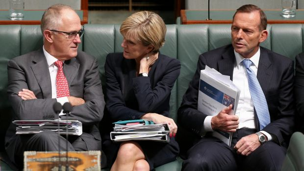 Communications Minister Malcolm Turnbull, Foreign Affairs Minister Julie Bishop and Prime Minister Tony Abbott later in ...