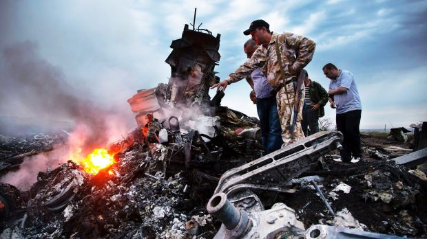 Inspectors search the MH17 crash site in Ukraine, in July, 2014.
