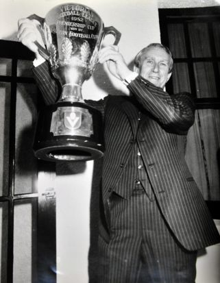 Former Prime Minister Malcolm Fraser with the AFL Premership Cup as he hosts a dinner at the Lodge for players, ...