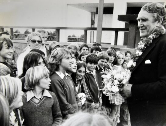 Former Prime Minister Malcolm Fraser arrives at the National Library to open an exhibition and is greeted by children of ...