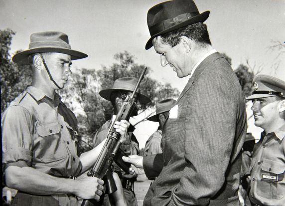 Former Prime Minister Malcolm Fraser inspects the rifle of of Duntroon Cadet G.R. Webb. (9/2/66)