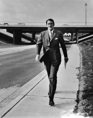 Former Prime Minister Malcolm Fraser when he was the Minister for Education and Science striding to work from his home ...