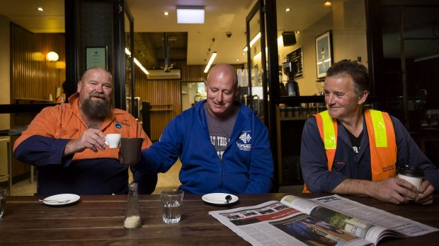 Construction workers (from left) Ron Horn, David Jones and Theo Argyros having early morning coffee before  work, at ...