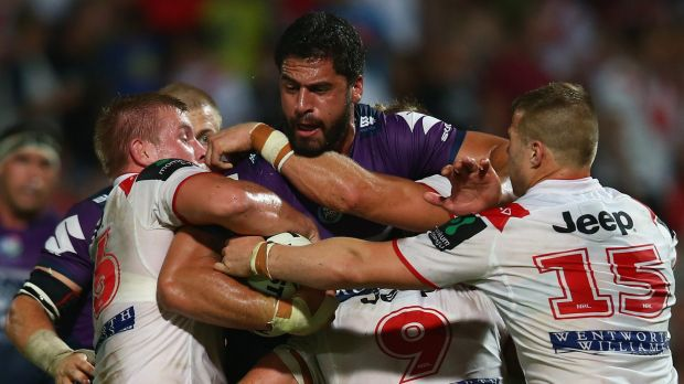 Jesse Bromwich, seen here being tackled in the game against the Dragons, says the Storm is ready for the Sharks.