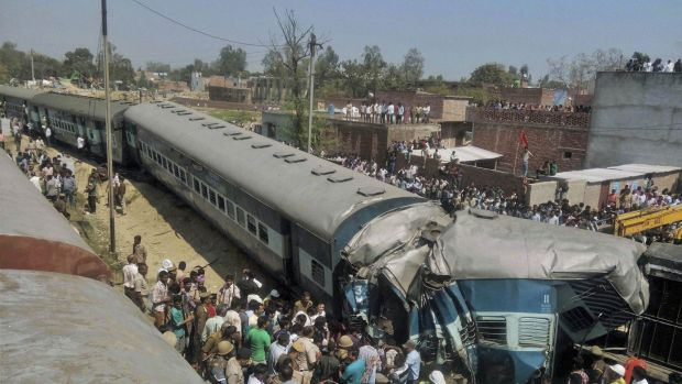 Indian rescue workers gather at the site of a train accident near Bachhrawan village in Uttar Pradesh state, India.