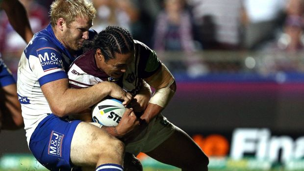 Controversial moment:  Steve Matai of the Sea Eagles scores a try despite the tackle, and protests, of Aiden Tolman.