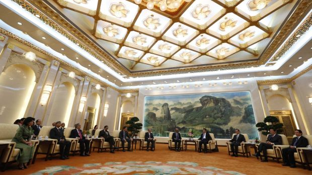 China's President Xi Jinping (fourth right) meets guests at the Asian Infrastructure Investment Bank (AIIB) launch ...