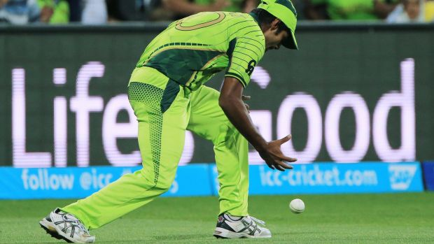 Costly spill: Pakistan's Rahat Ali drops a catch off Shane Watson in Adelaide on Friday night.