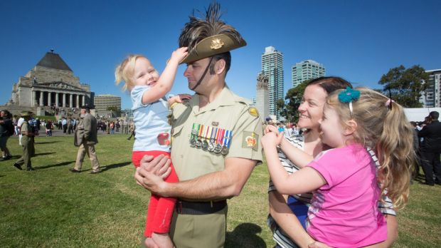 'A sense of belonging': Chris Sharp, who served as a sergeant, holds daughter Ruby, while his wife Jocelyn is pictured ...