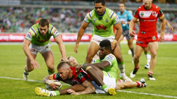 Former Raider Joel Thompson scores the match-winning try for the Dragons.