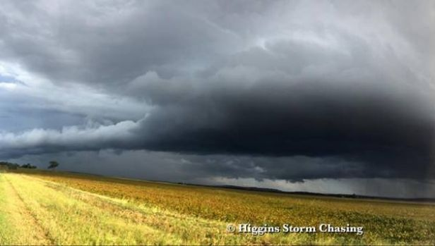 Afternoon storms roll across fields south of Toowoomba on Sunday.