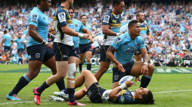 Unstoppable: Israel Folau goes over for the Waratahs.