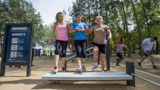 Bella Gay, Renee Gallo and Jane Carder at one of the ACT's outdoor fitness stations in Belconnen.