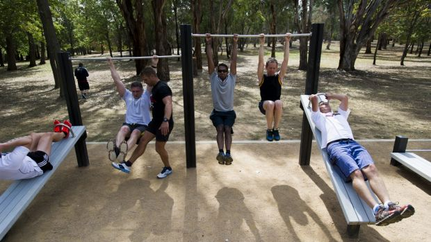 Health and fitness guru Lee Campbell takes a workout session for Territory and Municipal Services staff at one of the ...