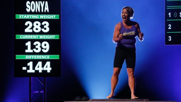 A contestant celebrates her weight loss on the most recent season finale of <i>The Biggest Loser</i> US.