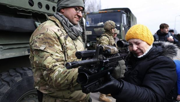 A US Army soldier shows a gun to a woman during the ''Dragoon Ride'' military exercise in Lithuania last year. The ...