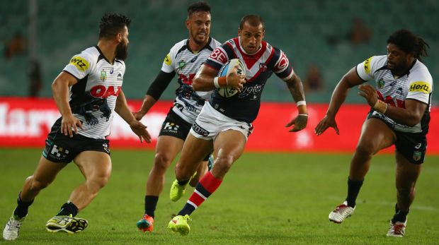 Raiders reunion: Blake Ferguson makes a break for the Sydney Roosters during the round three NRL match against the ...