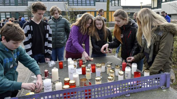 Students light candles at the Joseph-Koenig Gymnasium in Haltern, Germany. Sixteen school children and two teachers from ...