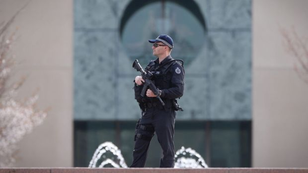 An Australian Federal Police officer stands sentry at the ministerial wing of Parliament House in September 2014.