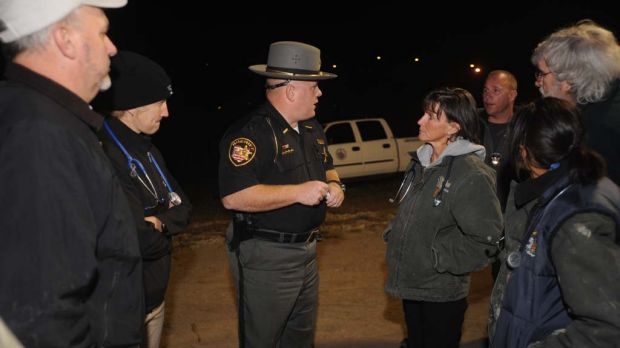 Muskingum County Sheriff Matt Lutz speaks to individuals from The Wilds, a wildlife conservation centre in Cumberland, ...