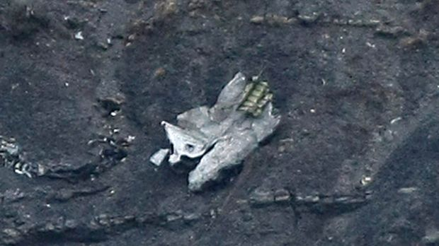 Debris of the crashed Germanwings passenger jet is scattered on the mountain side.