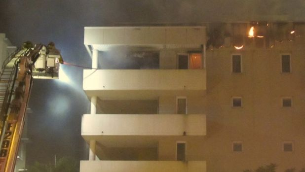 Firefighters battle a blaze that broke out in H block of Cathedral Place in 2013.