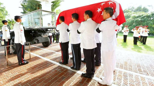 The Guard of Honour carry the casket of Lee Kuan Yew onto a gun carriage to Parliament House from the Istana on Wednesday.