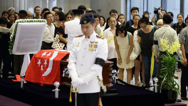 People pay their last respects to the body of Lee Kuan Yew lying in state at Parliament House.
